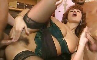 The Elegant Simona Valli Taking Two Dicks on the Sofa
