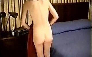 Kris Posing On The Bed Showing Her Hairy Snatch